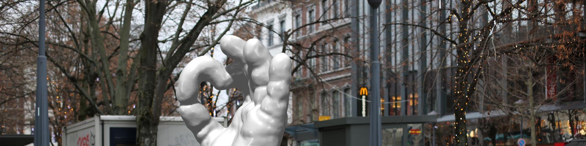Statue de main géante en forme de ok